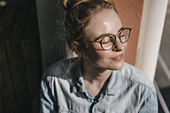 Young woman with glasses in sunlight - KNSF01467