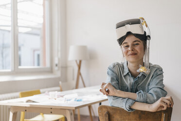 Portrait of smiling young woman with VR glasses and snorkel - KNSF01470