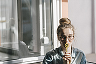 Portrait of young woman with power cable - KNSF01482