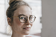 Portrait of young woman with glasses - KNSF01497