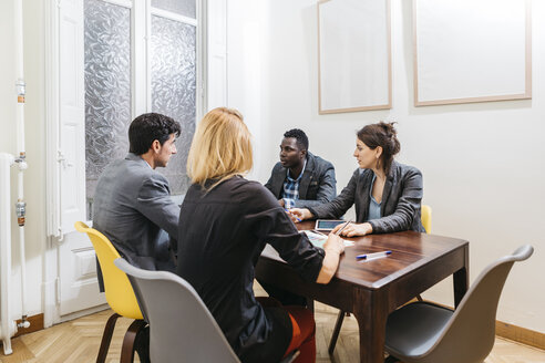 Young business people having a meeting in board room - JRFF01378