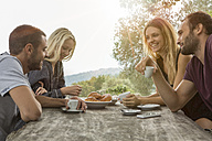 Two couples having fun at breakfast table - ZOCF00447