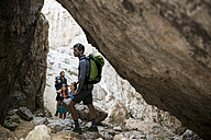 Italy, Friends climbing rocks in the Dolomites - ZOCF00475