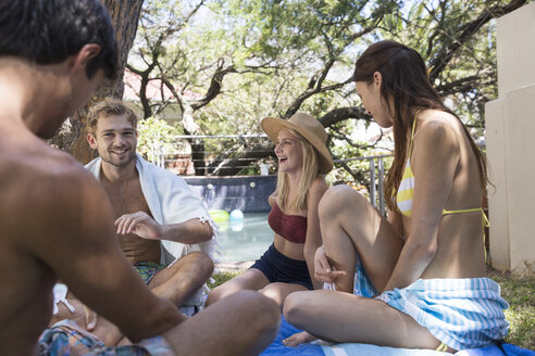 Group of happy friends relaxing in garden at the poolside - WESTF23220