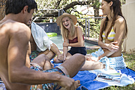 Group of happy friends relaxing in garden at the poolside - WESTF23223