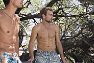 Two young men in swimming trunks outdoors - WESTF23241