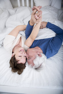 Senior couple having fun in bed - WESTF23346