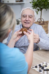 Gereatric nurse doing dexterity games with elderly patient - WESTF23373