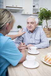 Gereatric nurse listening to elderly patient - WESTF23385