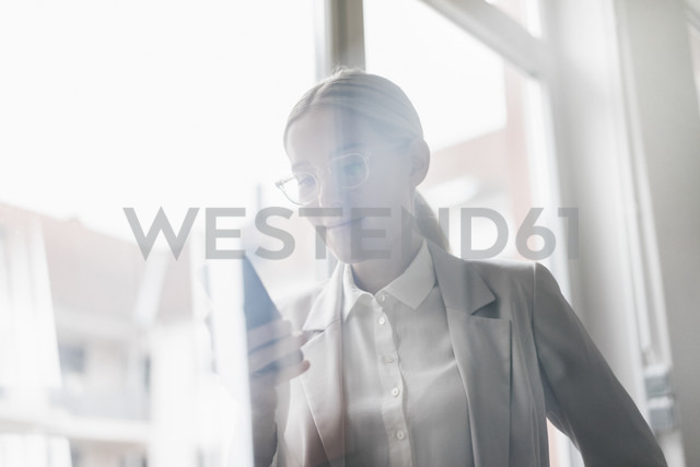 Portrait of businesswoman using cell phone - JOSF01058