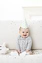 Portrait of baby boy wearing paper hat - FSF00927
