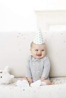 Portrait of baby boy wearing paper hat - FSF00927