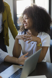 Smiling businesswoman during a meeting in office - GIOF02644