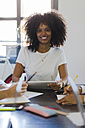 Portrait of smiling businesswoman during a meeting in office - GIOF02647