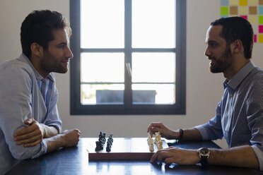 Two businessmen playing chess - GIOF02707