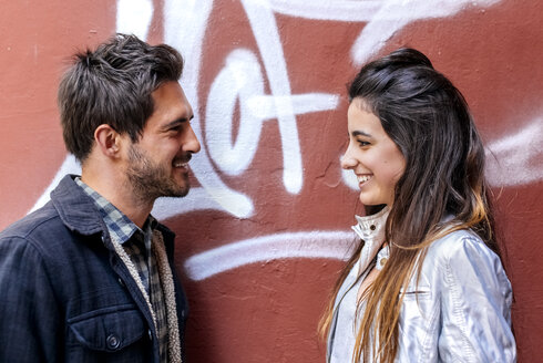 Couple smiling at each other - MGOF03400