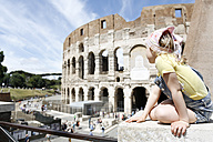 Italy, Rome, girl looking at colosseum - FKF02335