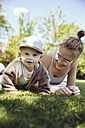 Portrait of baby boy with his mother on a meadow in the garden - MFF03641