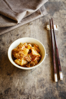 Fresh house made kimchi with chopsticks - EVGF03224