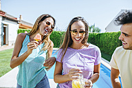 Happy friends with drink and watermelon at the poolside - KIJF01508