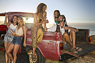 Happy young people outside pick up truck at the coast - ZEF13914