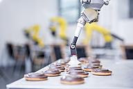 Close-up of industrial robot handling cookies - WESTF23426