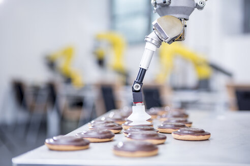 Close-up of industrial robot handling cookies - WESTF23426