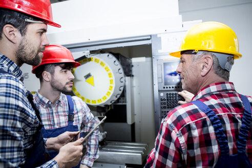 Staff in factory at CNC machine - WESTF23471
