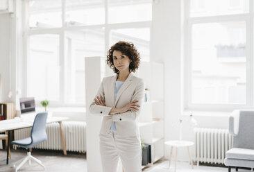 Businesswoman in office looking determined - KNSF01601
