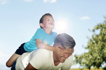 Father playing with son outdoors - ZEF13952