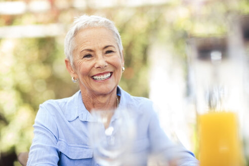 Portrait of smiling senior woman outdoors - ZEF13958