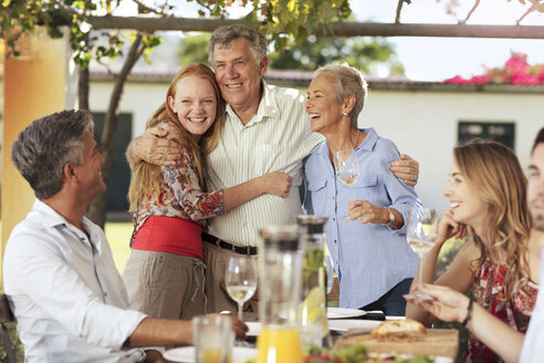 Happy senior couple with family having lunch together outside - ZEF13976