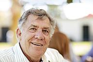 Portrait of smiling senior man outdoors - ZEF13979
