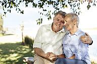 Happy senior couple in garden - ZEF13991