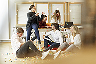 Playful creative professionals meeting in office - PESF00636