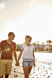 Couple in love walking hand in hand on the beach - PACF00002