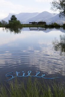 Word Stille floating on water surface - PSTF00043