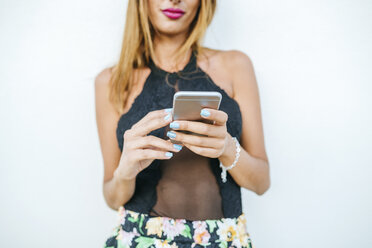 Close-up of woman holding cell phone - KIJF01619