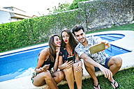 Friends taking a selfie at the poolside - KIJF01631
