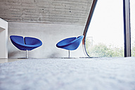 Two chairs in empty attic office - RHF02009