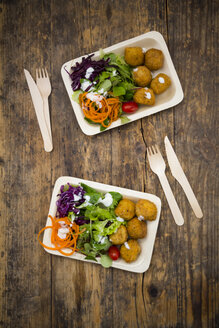 Falafel and salad on wooden disposable plates and cutlery - LVF06163