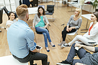 Business people having a project meeting in office - ZEDF00612