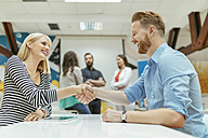 Business people shaking hands in office - ZEDF00621