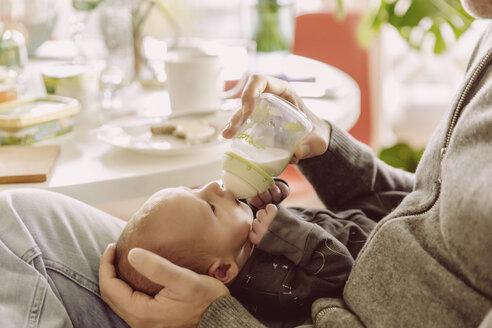 Father bottle-feeding his newborn baby boy - MFF03659