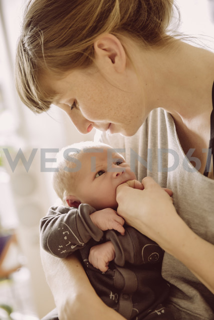 Mother testing newborn baby's hunger with her finger - MFF03668