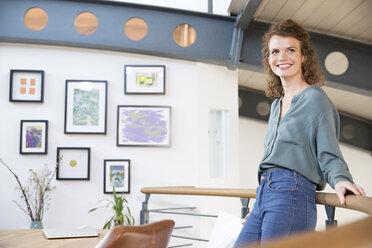 Smiling woman in modern office - FKF02354