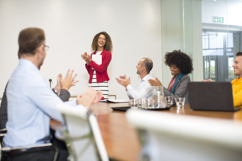 Business people applauding during a meeting in boardroom - ZEF13998