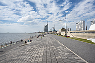 Germany, Bremerhaven, waterfront promenade with Atlantic Hotel Sail City in background - ELF01842