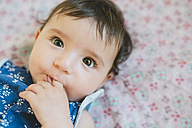 Portrait of baby girl with finger in mouth - GEMF01694