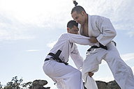 Men doing combat exercises during a martial arts training - ABZF02109